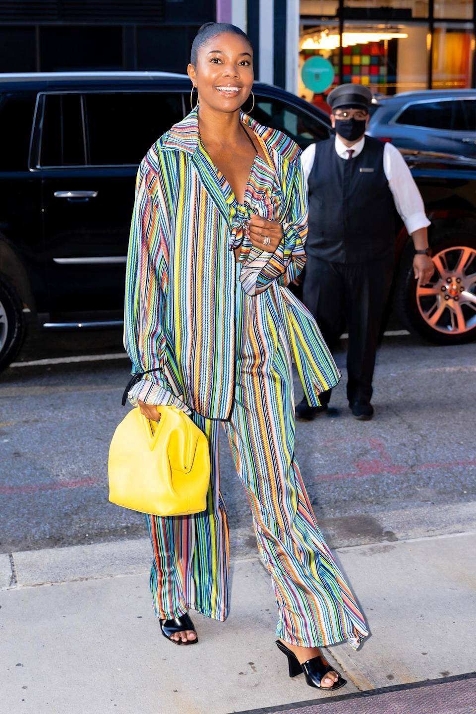 <p>Gabrielle Union smiles wide while out in N.Y.C. on June 17.</p>