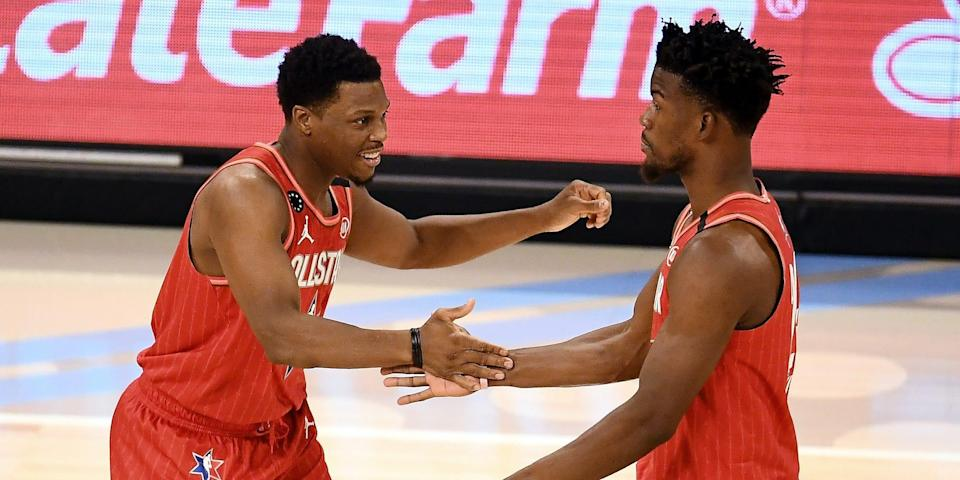 Kyle Lowry and Jimmy Butler high-five during the 2020 NBA All-Star Game.