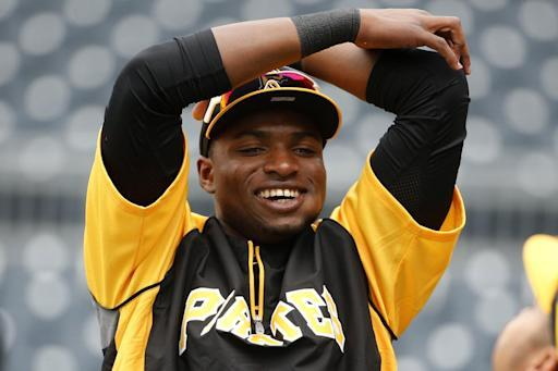 Pittsburgh Pirates' Gregory Polanco stretches during warm ups before a baseball game against the Chicago Cubs in Pittsburgh Tuesday, June 10, 2014. It will be Polanco's Major League debut. (AP Photo/Gene J. Puskar)