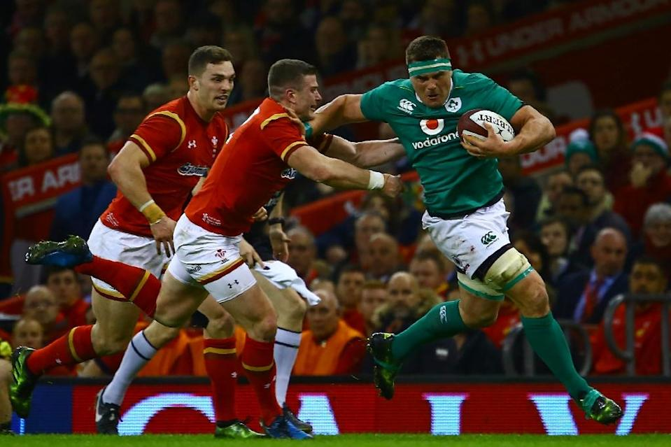 Ireland's flanker CJ Stander (R) tries to hand-off Wale's centre Scott Williams during their Six Nations rugby union match, at the Principality Stadium in Cardiff, south Wales, on March 10, 2017 (AFP Photo/Geoff Caddick)
