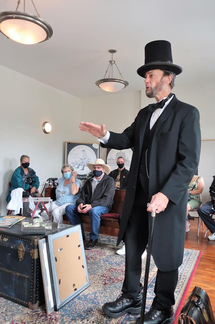 An Abraham Lincoln impersonator recites portions of the Gettysburg Address at the Lincoln Museum in Hodgenville, Kentucky.