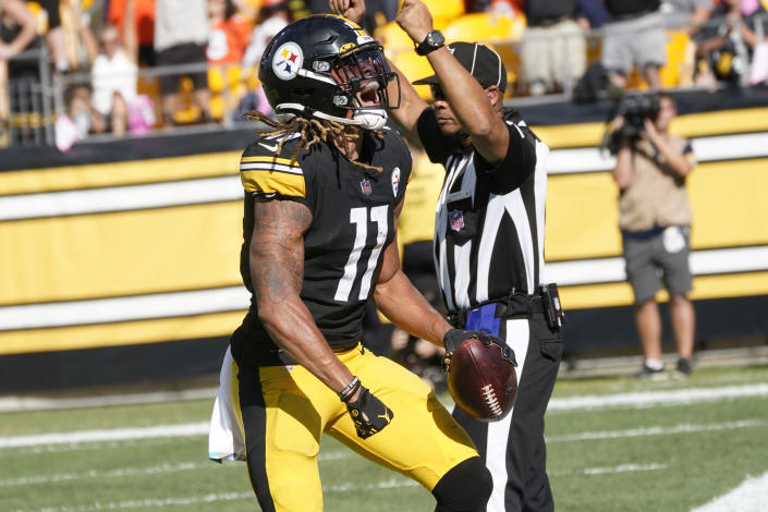 Pittsburgh Steelers wide receiver Chase Claypool celebrates after catching a pass from quarterback Ben Roethlisberger for a touchdown during the second half of an NFL football game against the Denver Broncos in Pittsburgh, Sunday, Oct. 10, 2021. (AP Photo/Don Wright)