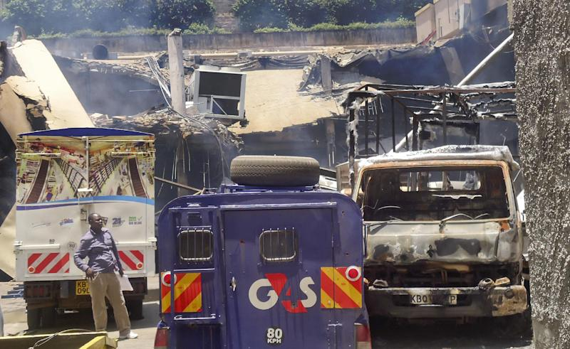 This photo taken Saturday, Sept. 28, 2013 and made available Monday, Sept. 30, 2013, shows burnt vehicles and the collapsed upper car park at the Westgate Mall in Nairobi, Kenya. The four-day siege, which included the collapse of part of the mall, left 67 people dead, according to officials. (AP Photo)
