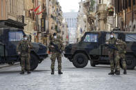 Italian Army officers patrol Rome's central Piazza del Popolo, Saturday, April 3, 2021. Italy went into lockdown on Easter weekend in its effort to battle then Covid-19 pandemic. (AP Photo/Gregorio Borgia)