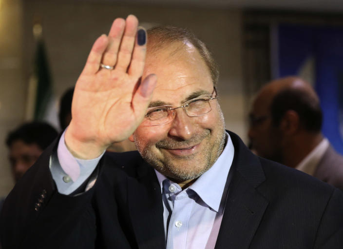 FILE -- Tehran's mayor, Mohammad Bagher Qalibaf, a former Revolutionary Guard commander, waves to media with an ink-stained finger, after registering his candidacy for the upcoming presidential election, at the election headquarters of the interior ministry in Tehran, Iran, Saturday May 11, 2013. Iran's reformist-backed presidential candidate Hasan Rowhani surged to a wide lead in early vote counting, the Interior Ministry reported, well ahead of Tehran Mayor Mohammad Bagher Qalibaf, who was running second.Qalibaf was boosted by a reputation as a steady hand for Iran's sanctions-wracked economy. (AP Photo/Ebrahim Noroozi, File)
