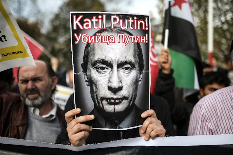 """A poster reads """"Putin, killer!"""" at a demonstration against Russia on November 27, 2015, in Fatih district in Istanbul (AFP Photo/Cagdas Erdogan)"""