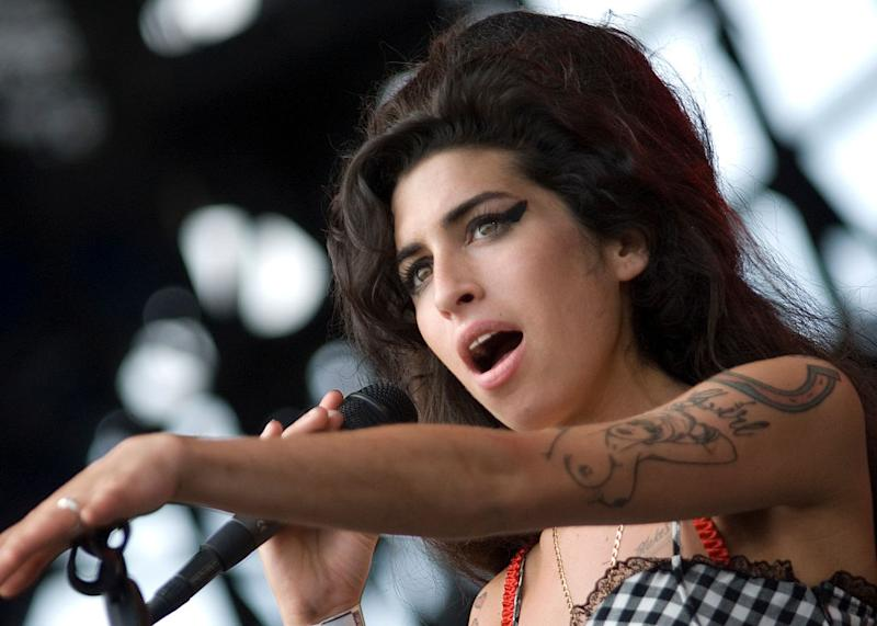 UNITED STATES - AUGUST 05: LOLLAPALOOZA Photo of Amy WINEHOUSE, Amy Winehouse performing on stage (Photo by Daniel Boczarski/Redferns)