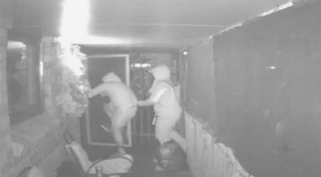 ...before kicking the front door in. Photos: NSW Police