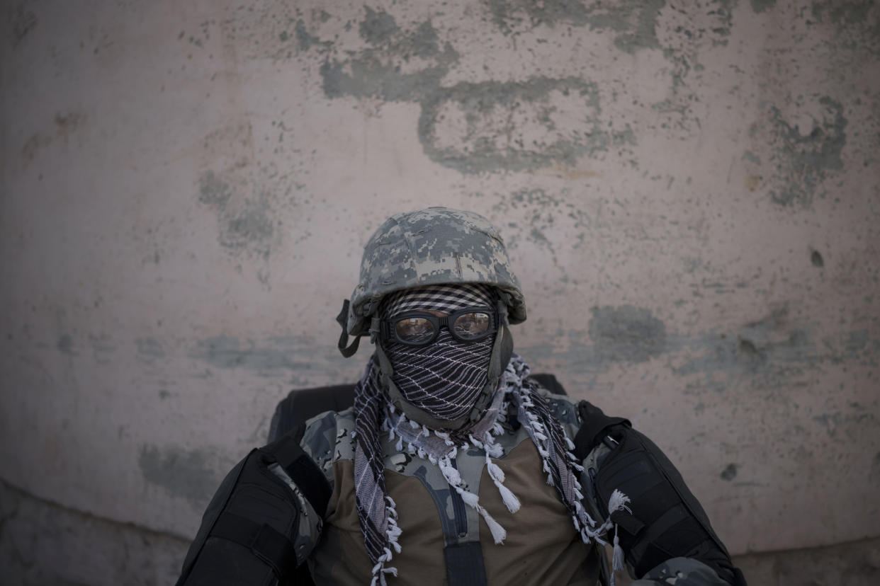 A Taliban fighter guards the entrance of the Pul-e-Charkhi prison in Kabul, Afghanistan, Monday, Sept. 13, 2021. Pul-e-Charkhi was previously the main government prison for holding captured Taliban and was long notorious for abuses, poor conditions and severe overcrowding with thousands of prisoners. Now after their takeover of the country, the Taliban control it and are getting it back up and running, current holding around 60 people, mainly drug addicts and accused criminals. (AP Photo/Felipe Dana)