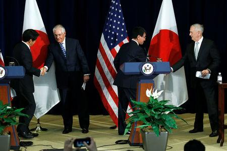 Japan's Defense Minister Itsunori Onodera (L-R), U.S. Secretary of State Rex Tillerson, Japan's Foreign Minister Taro Kono and U.S. Defense Secretary James Mattis shake hands at the end of a news conference after their U.S.-Japan Security talks at the State Department in Washington, U.S., August 17, 2017. REUTERS/Jonathan Ernst