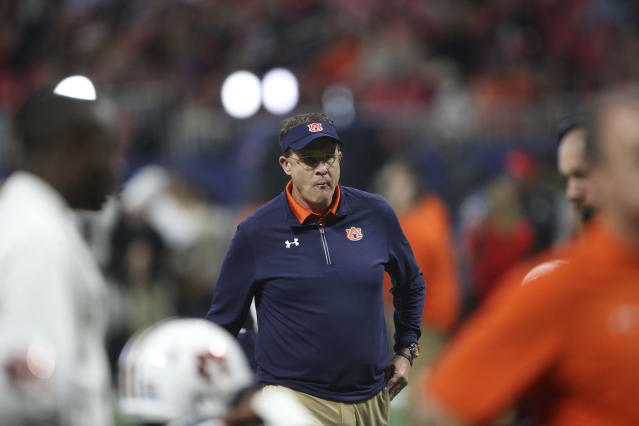 Auburn head coach Gus Malzahn watches teams warm up before the first half of the Southeastern Conference championship vs. Georgia. (AP Photo/John Bazemore)