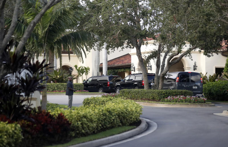 FILE- In this Nov. 24, 2017, file photo, the motorcade for President Donald Trump arrives at the Trump National Golf Club in Jupiter, Fla. The corporation that owns Trump National Golf Club is suing Palm Beach County Property Appraiser Dorothy Jacks, saying her office's estimated value of $19 million is too high. The course received a tax bill of nearly $400,000. (AP Photo/Alex Brandon, File)