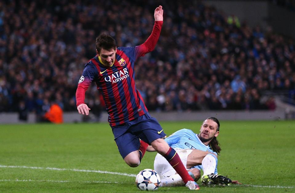 Martin Demichelis of Manchester City fouls Lionel Messi of Barcelona to concede a penalty and is subsequently sent off during the UEFA Champions League Round of 16 - GETTY IMAGES