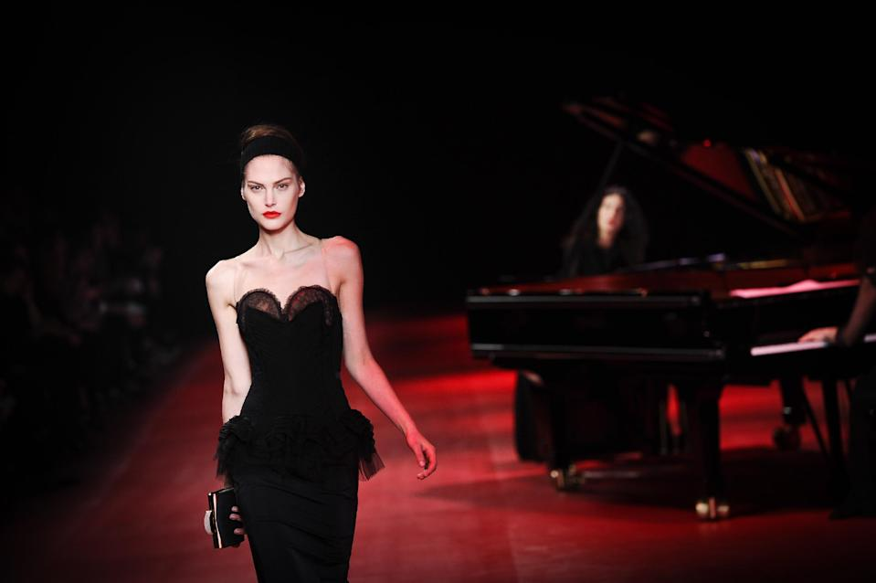 A model presents a creation by fashion designer Peter Copping as part of the Nina Ricci Ready to Wear's Fall-Winter 2013-2014 fashion collection, presented Thursday, Feb.28, 2013 in Paris. (AP Photo/Zacharie Scheurer)