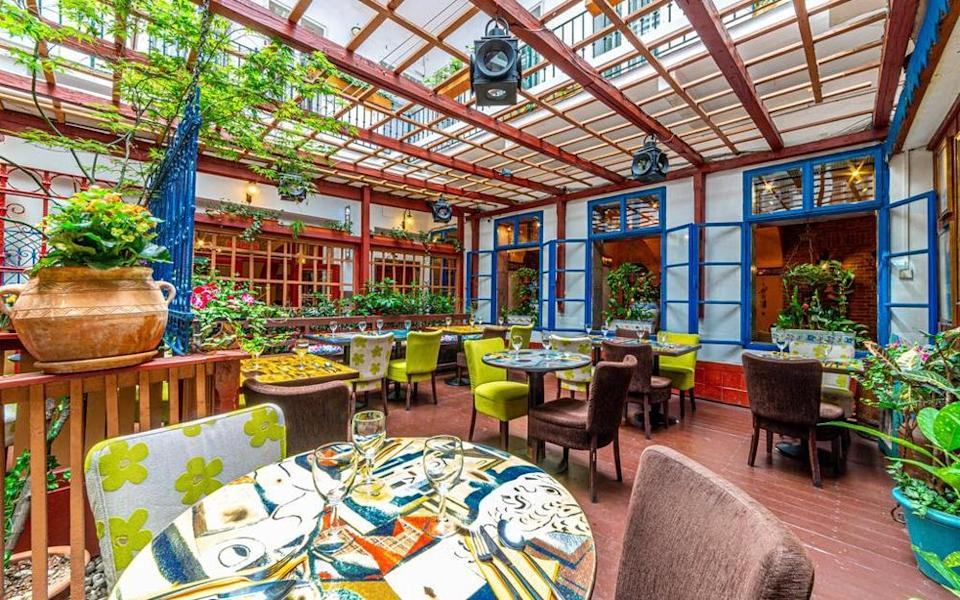 Hotel Salvator's restaurant, La Boca, has oodles of character thanks to colourful tilework on the floors and walls supported by vibrant posters, murals and table coverings
