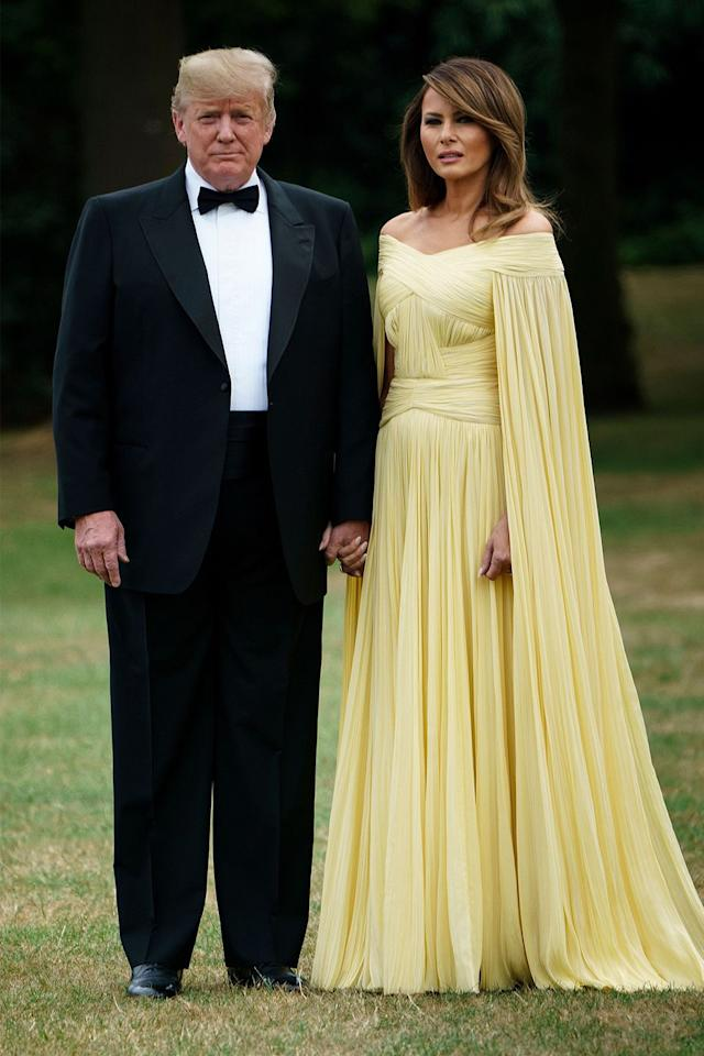 <p>The First Lady wore an off-the-shoulder caped gown designed by J. Mendel to a black-tie dinner at Blenheim Palace while on a tw0-day visit with the President to the UK.</p>