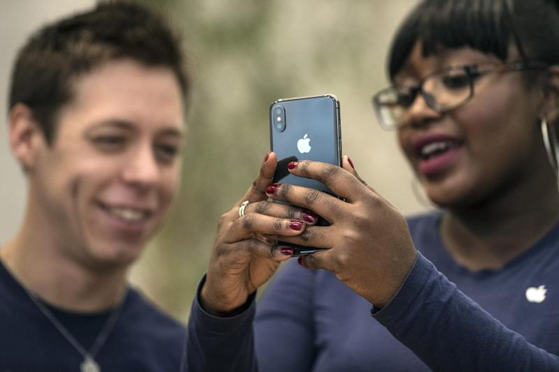Staff members view the new iPhone X in the Apple store upon its release in the U.K, on November 3, 2017 in London, England: Carl Court/Getty Images
