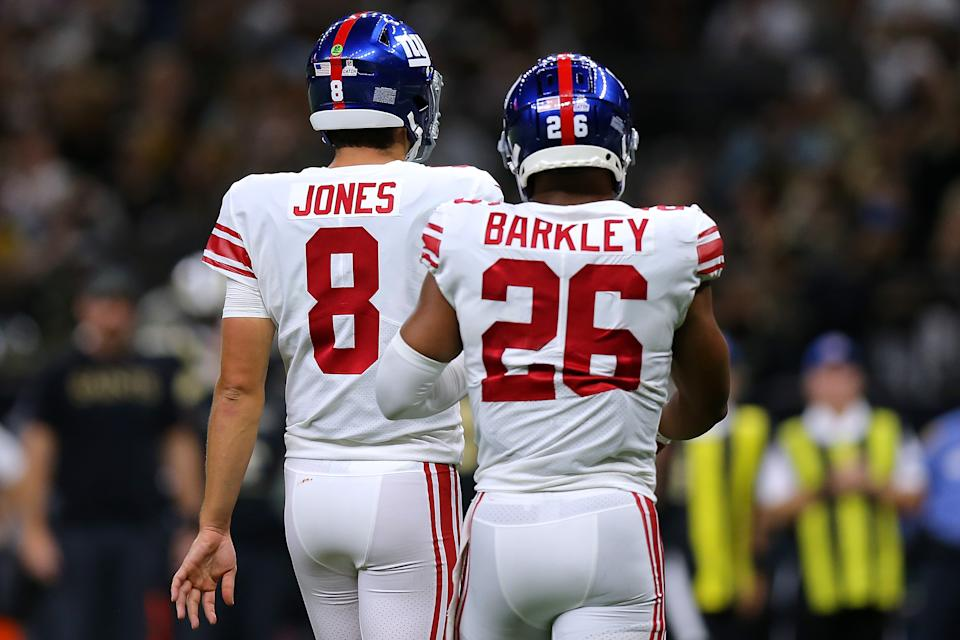 NEW ORLEANS, LOUISIANA - OCTOBER 03: Daniel Jones #8 of the New York Giants and Saquon Barkley #26 react against the New Orleans Saints during a game at the Caesars Superdome on October 03, 2021 in New Orleans, Louisiana. (Photo by Jonathan Bachman/Getty Images)