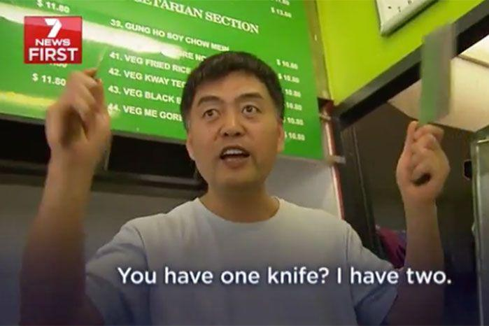 That's not a knife... THIS is a knife - Mr Hu chases the would-be-thief out of his shop. Photo: 7 News.