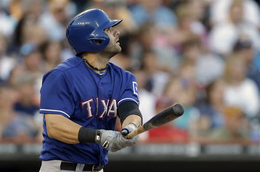 Texas Rangers' Mitch Moreland watches his two-run home run clear the left field wall during the fourth inning of a baseball game against the Detroit Tigers in Detroit, Saturday, July 13, 2013. (AP Photo/Carlos Osorio)