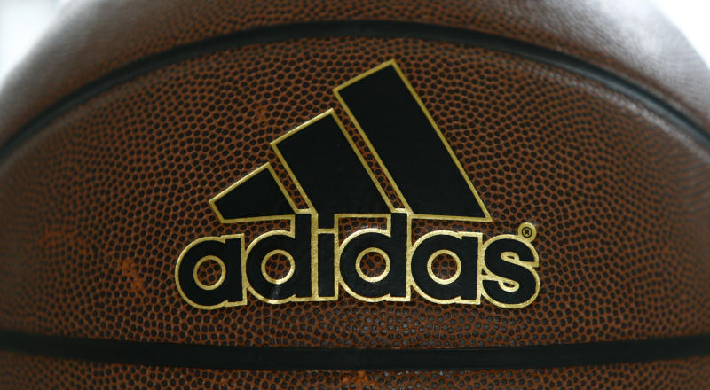 An Adidas logo is pictured on a basketball after the annual news conference at teh company's headquarters in the northern Bavarian town of Herzogenaurach, near Nuremberg March 3, 2016. REUTERS/Michaela Rehle