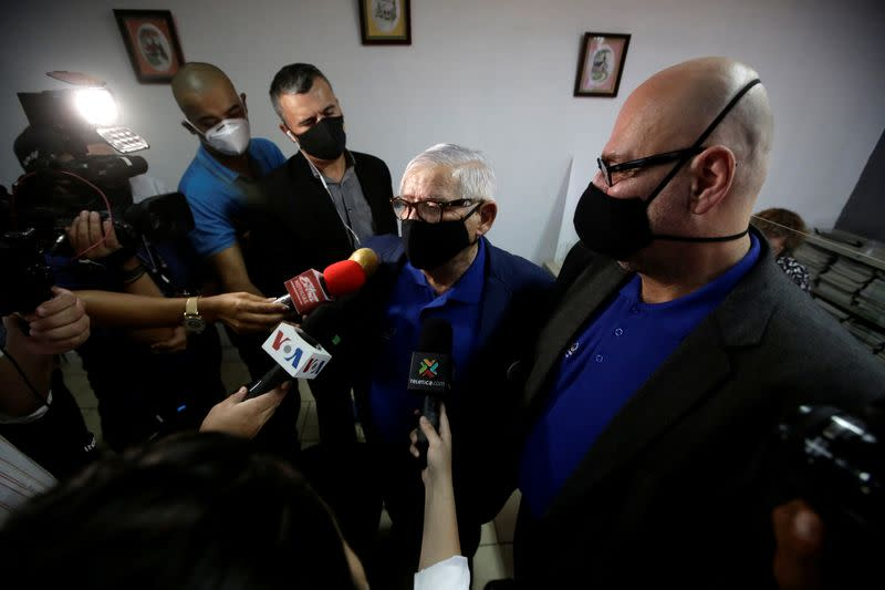 Rodrigo Campos and his partner Marcos Castillo speak to the media following their marriage ceremony, after Costa Rica legalised same-sex marriage, in San Jose