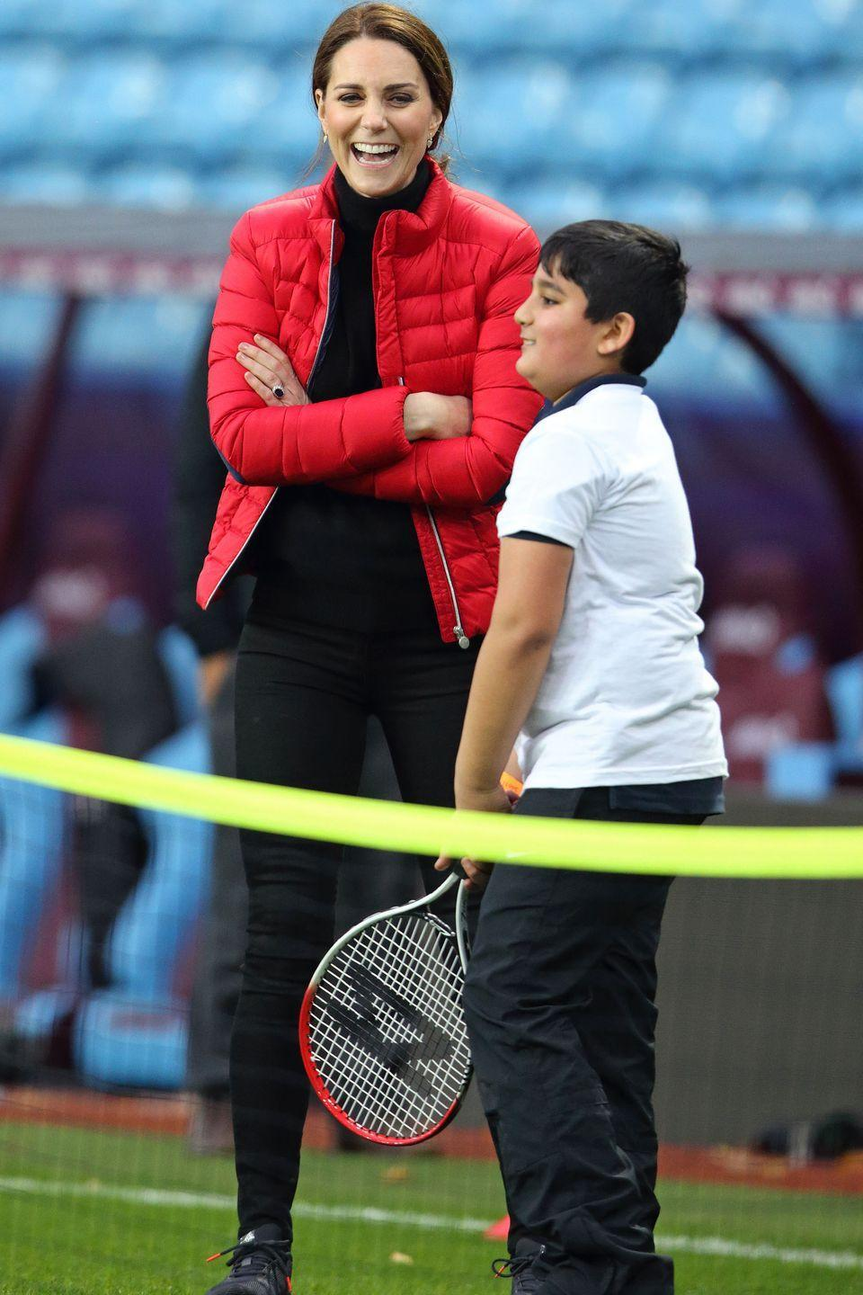 <p>The Duchess watches a tennis lesson while visiting the Aston Villa Football Club to see the work of the Coach Core program.</p>
