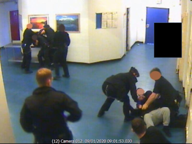 Prison officers restraining two inmates after an alleged terror attack at HMP Whitemoor in Cambridgeshire on 9 January 2020 (Metropolitan Police )