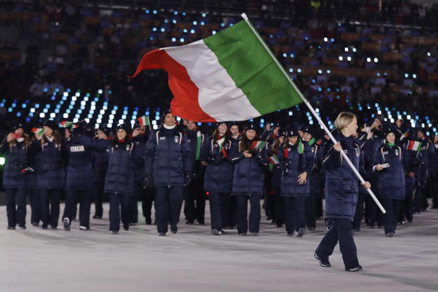 <p>Arianna Fontana carries the flag of Italy during the opening ceremony of the 2018 Winter Olympics in Pyeongchang, South Korea, Friday, Feb. 9, 2018. (AP Photo/Petr David Josek) </p>