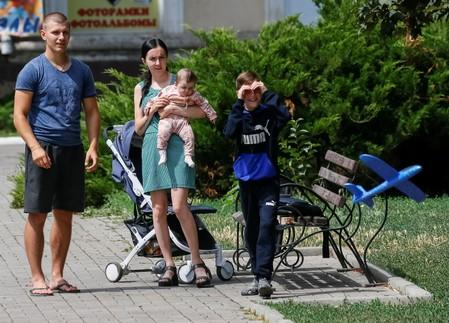 A family rests in a park, central Bakhmut