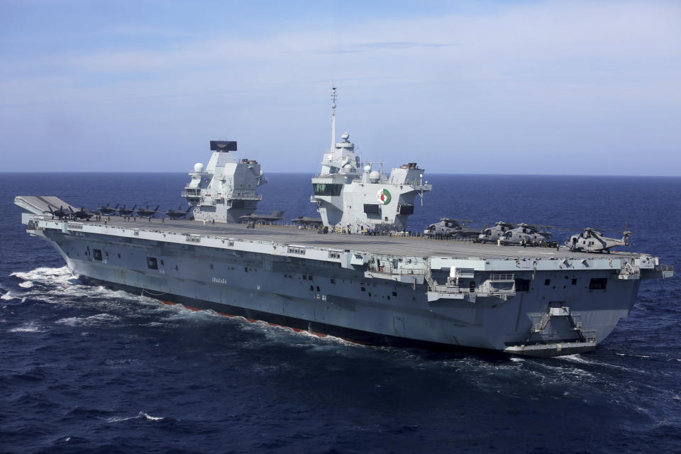 FILE - In this May 27, 2021, file photo, military personnel participate in a NATO training exercise on board the UK Royal Navy aircraft carrier HMS Queen Elizabeth off the coast of Portugal. With increasingly strong talk in support of Taiwan, a new deal to supply Australia with nuclear submarines, and the launch of a European strategy for greater engagement in the Indo-Pacific, the U.S. and its allies are becoming growingly assertive in their approach toward a rising China. (AP Photo/Ana Brigida, File)