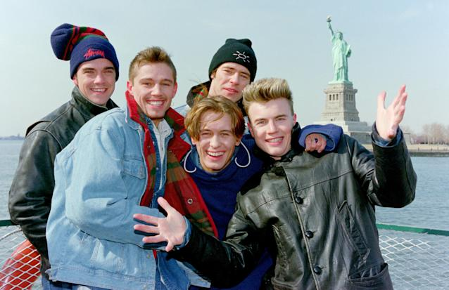 Mark Owen, Howard Donald, Gary Barlow, Robbie Williams and Jason Orange of Take That visit the Statue of Liberty in New York, 1995 (Photo by DaveHogan/Getty Images)