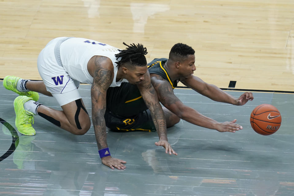 Washington's Nate Roberts, left, and Baylor's Mark Vital scramble for the ball during the second half of an NCAA college basketball game Sunday, Nov. 29, 2020, in Las Vegas. (AP Photo/John Locher)