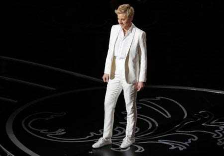 Host Degeneres stands on stage at the 86th Academy Awards in Hollywood