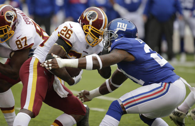 "<a class=""link rapid-noclick-resp"" href=""/nfl/players/8261/"" data-ylk=""slk:Adrian Peterson"">Adrian Peterson</a> ran through, around, and past the Giants in Sunday's 20-13 victory(AP Photo/Seth Wenig)"