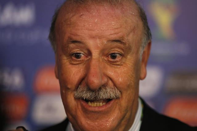 Spain head coach Vicente Del Bosque answers journalists' questions after the draw ceremony for the 2014 soccer World Cup in Costa do Sauipe near Salvador, Brazil, Friday, Dec. 6, 2013. (AP Photo/Victor R. Caivano)