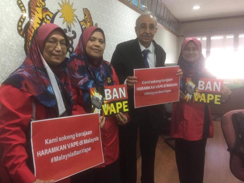 Members of the coalition of NGOs seeking a blanket ban on e-cigarettes and vaping devices pose for pictures at a press conference. — Picture courtesy of Smoke Free Malaysia Initiative