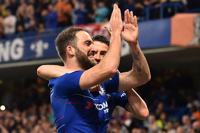 Chelsea's Argentinian striker Gonzalo Higuain celebrates scoring their second goal against Burnley at Stamford Bridge (Photo by GLYN KIRK/AFP/Getty Images)