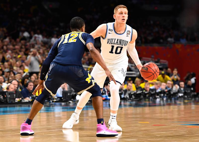 Ball gets stuck on rim during NCAA title game after Villanova's first-half star Donte DiVincenzo blocks it twice