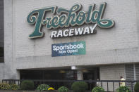 This Oct. 24, 2020 photo shows the exterior of the Freehold Raceway track in Freehold, N.J. The track, in an agreement reached Tuesday, Jan. 12, 2021, has partnered with Australian company PlayUp to offer mobile sports betting in New Jersey. Freehold is the third New Jersey track to offer sports betting.(AP Photo/Wayne Parry)