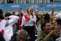 England fans celebrate their team's second goal as they watch the Euro 2020 round of 16 soccer championship match between England and Germany being played at London's Wembley stadium, at a fan zone in central Trafalgar Square in London, Tuesday, June 29, 2021. England won 2-0. (AP Photo/Matt Dunham)