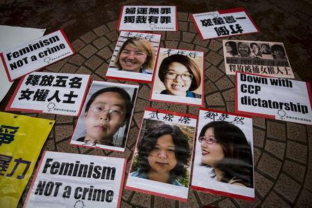 Portraits of Li Tingting (top L), Wei Tingting (top R), (bottom, L-R) Wang Man, Wu Rongrong and Zheng Churan are pictured during a protest calling for their release in Hong Kong, in this April 11, 2015 file photo. Feminists in China are embracing Taiwan's presidential front-runner Tsai Ing-wen as a role model - in a country where the last woman leader was the empress dowager more than a century ago. REUTERS/Tyrone Siu/Files
