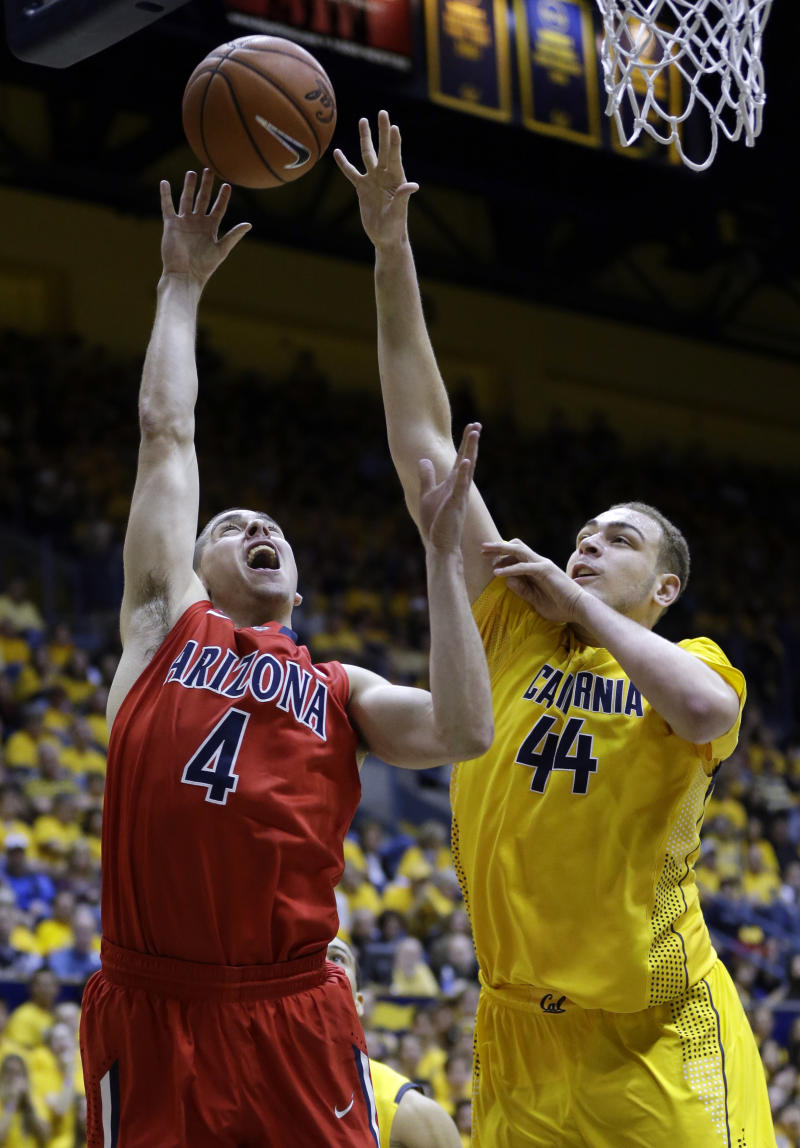 Arizona guard T.J. McConnell, left, shoots over California center Kameron Rooks during the first half on an NCAA college basketball game on Saturday, Feb. 1, 2014, in Berkeley, Calif. (AP Photo/Marcio Jose Sanchez)