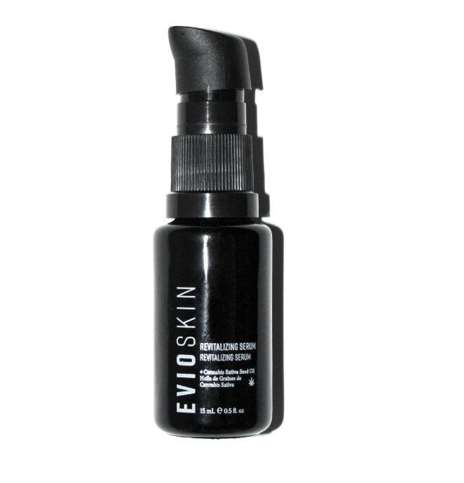 """This golden-hued serum feels so luxurious on our skin we had to do a double take at the price: $24!Made with cannabis sativa seed oil (not to be confused with CBD or THC), it comes out of the sleek bottle quite generously so a little pump is all you need to massage this nourishing oil serum into your entire face and lips. <a href=""""https://eviobeauty.com/products/revitalizing-serum"""" target=""""_blank"""" rel=""""noopener noreferrer"""">Get it here</a>."""