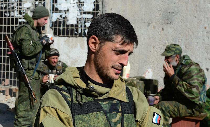 "Givi, commander of the pro-Russian separatist ""Somali battalion"", speaks to reporters at a lookout centre near Donetsk's Sergey Prokofiev international airport, on October 9, 2014 (AFP Photo/John MacDougall)"