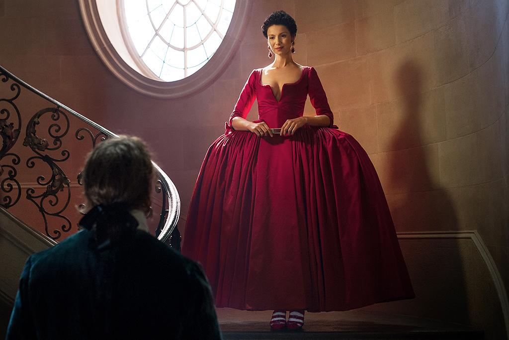 """<p><em>Outlander</em> costume designer Terry Dresbach knew the stakes were high when it came time for Caitriona Balfe to don Claire's red dress, a key moment in the second <em>Outlander</em> novel, <em>Dragonfly in Amber</em>. <a rel=""""nofollow"""" href=""""https://www.yahoo.com/tv/outlander-costume-designer-terry-dresbach-talks-020213539.html?soc_src=mail&soc_trk=ma"""">As she told her husband</a> — and series showrunner — Ronald D. Moore, if they didn't get it absolutely right, fans would """"burn us at the stake."""" Fortunately for their continued survival, viewers' jaws dropped even further than Jamie's when Claire descended that staircase clad in resplendent red. Simply put, that dress is the hottest in haute couture. —<em>Ethan Alter</em> <br />(Photo: Starz) </p>"""
