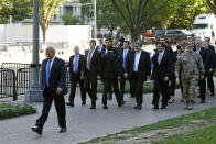 FILE - In this June 1, 2020 file photo, President Donald Trump walks in Lafayette Park to visit outside St. John's Church across from the White House in Washington. An internal investigation has determined that the decision to clear racial justice protestors from an area in front of the White House last summer was not influenced by then-President Donald Trump's plans for a photo opportunity at that spot. The report released Wednesday by the Department of Interior's Inspector General concludes that the protestors were cleared by U.S. Park Police on June 1 of last year so new fencing could be installed. (AP Photo/Patrick Semansky)