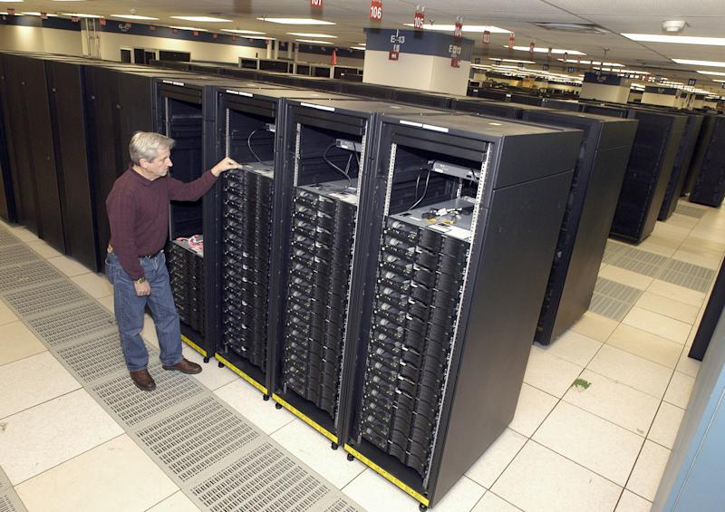 "This undated handout photo provided by IBM shows lead engineer Don Grice of IBM inspecting the world's fastest computer, nicknamed ""Roadrunner"", in the company's Poughkeepsie, N.Y. plant.  It's the end of the line for the supercomputer that was once the fastest in the world and best known for breaking the once-elusive petaflop barrier.  Roadrunner, the $121 million supercomputer housed at Los Alamos National Laboratory will be decommissioned on Sunday, March 31, 2013. The reason: The world of supercomputing is evolving. Roadrunner's replacement is faster, more energy efficient and less expensive. (AP Photo/IBM via FPS, HO)"