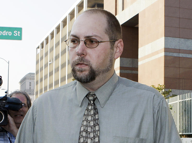 FILE - In this Nov. 1, 2011 file photo, Christopher Chaney, 35, of Jacksonville, Fla., leaves federal court in Los Angeles. Chaney has agreed to plead guilty to hacking into the email accounts of celebrities such as Christina Aguilera, Mila Kunis and Scarlett Johansson, whose nude photos eventually landed on the Internet, according to court documents filed Thursday, March 22, 2012. (AP Photo/Reed Saxon, File)