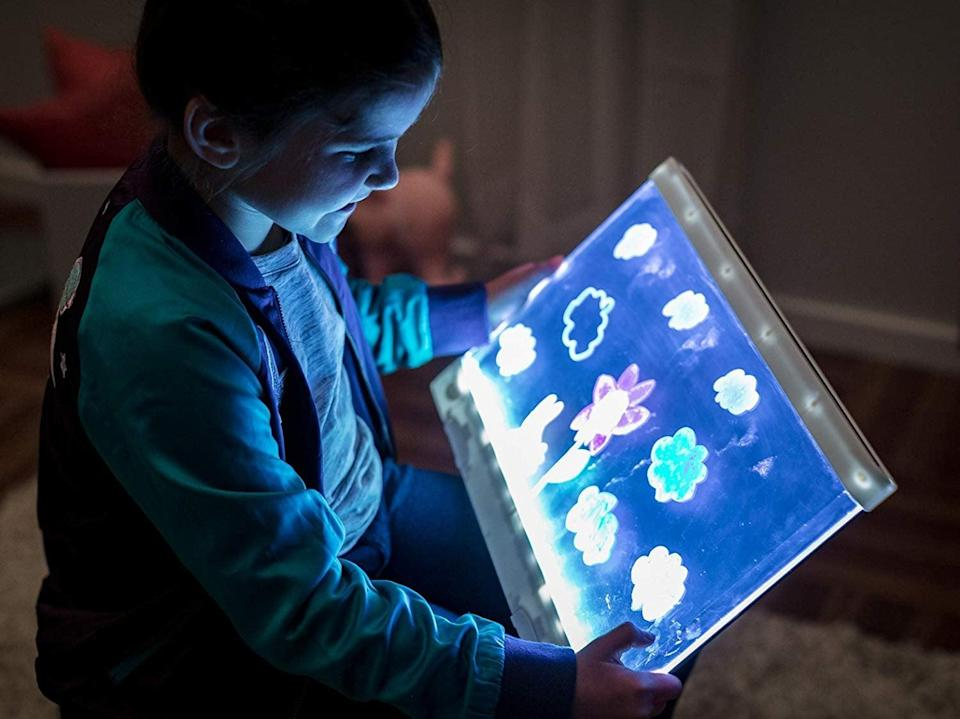 <p>This light-up <span>Crayola Ultimate Light Board</span> ($25) is fun because they can see their creations glow in the dark. The smaller size makes it easy to store and even travel with.</p>